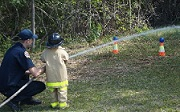 Image of child participating in a community firefighter event